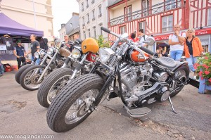 old custom motorcycles parked outside a hotel in Honfleur