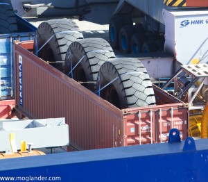 Photo of 3 huge tyres being shipped in a container