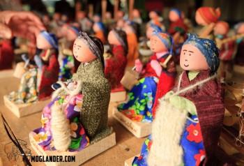 Many dolls at work