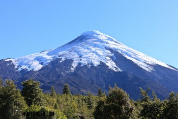 Volcano Osorno in Southern Chile. This competes with Mount Fuji in Japan for being the perfect volcano cone, and looking all pretty with it's snow cap.