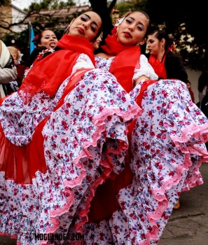 Dancing girls pose with their huge desses at the Gaucho festival in Salta, Argentina