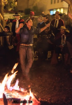 Traditional folk dancing by firelight