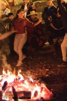 Traditional Argentinian Gaucho folk dancing by firelight