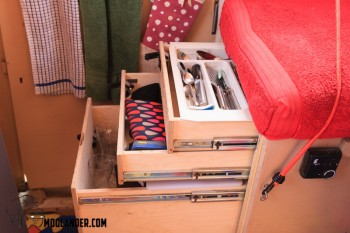 3 drawers hold a lot of stuff under the seat. Each one has a full extension slide, and locks closed for traveling.