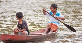 Kids playing in their boat on the Amazon river.