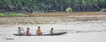 Kids in a canoe on the Amazon