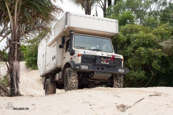 Photograph of Unimog Camper on its way through the sand dunes in Brazil